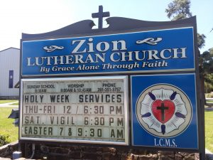 church sign listing the services for holy week